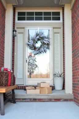 four brown gift boxes near a glass paneled door with wreath